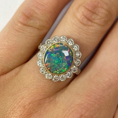 Lot 21-A gold boulder opal and diamond cluster ring