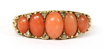 Lot 34 - A Victorian gold five stone coral and diamond ring