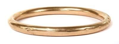 Lot 74 - A 9ct gold bangle