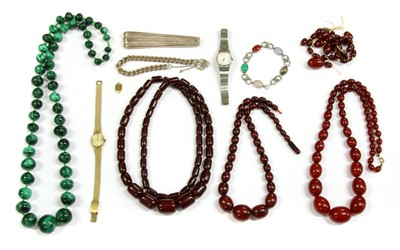 Lot 44 - Four single row graduated Bakelite bead necklaces