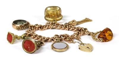 Lot 75 - A gold charm bracelet