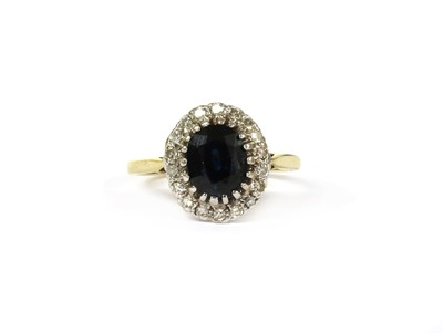 Lot 106 - An 18ct gold sapphire and diamond cluster ring