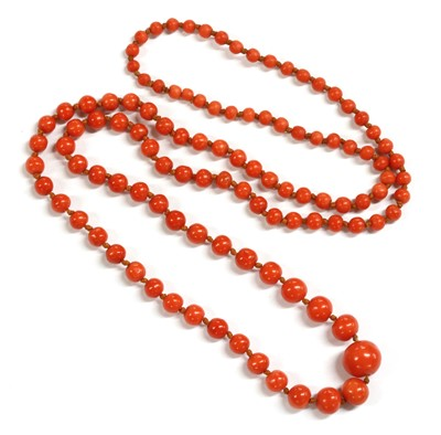 Lot 36 - A single row graduated coral bead necklace