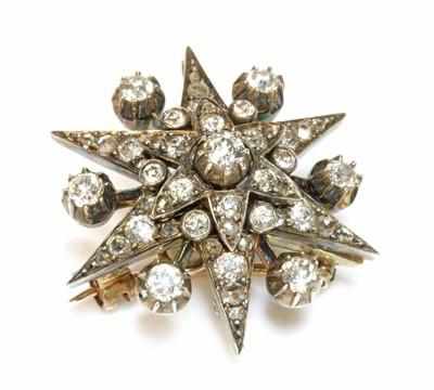 Lot 60 - A Victorian diamond set star brooch, c.1890