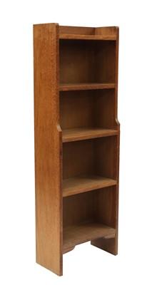 Lot 100 - An oak narrow waterfall bookcase