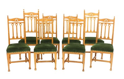Lot 51 - A set of eight Arts and Crafts oak dining chairs