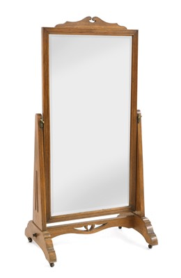 Lot 56 - An Arts and Crafts oak cheval mirror
