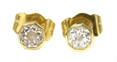 Lot 42 - A pair of 18ct gold single stone diamond stud earrings
