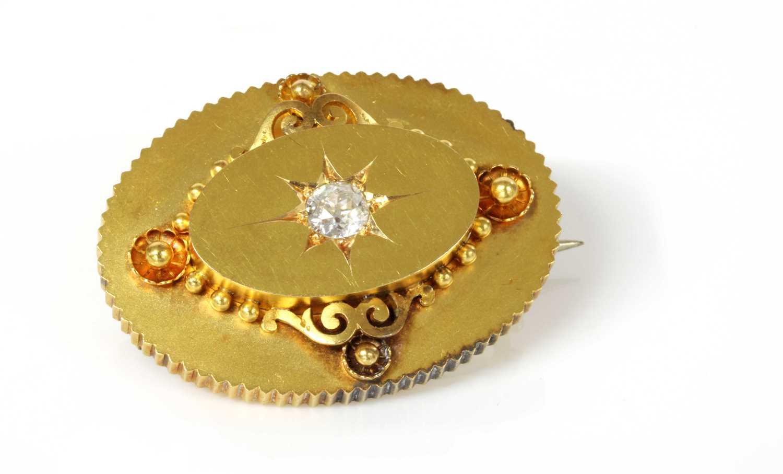 Lot 86 - A Victorian gold diamond set oval shield form brooch, c.1870