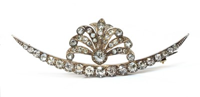 Lot 32 - A late Victorian diamond set crescent and spray brooch, c.1890