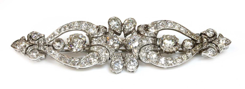 Lot 35 - A diamond set bar brooch