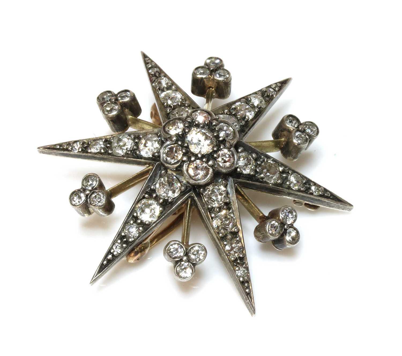 Lot 59 - A late Victorian diamond set star brooch/pendant, c.1890