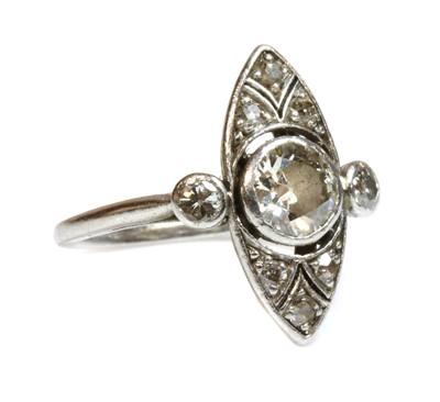 Lot 166 - An Art Deco platinum marquise shaped diamond set ring