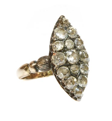 Lot 54 - A late Victorian marquise shaped diamond set cluster ring