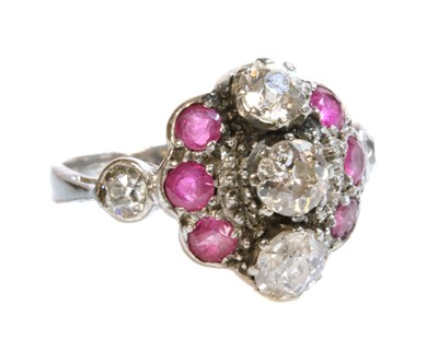 Lot 172 - A white gold diamond and ruby cluster ring, c.1935
