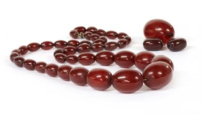 Lot 43 - A single row graduated cherry coloured Bakelite bead necklace