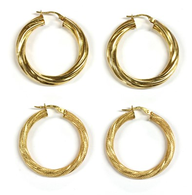 Lot 82 - Two pairs of 9ct gold hollow hoop earrings