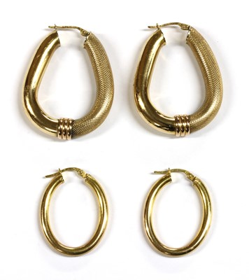 Lot 83 - Two pairs of 9ct gold hollow hoop earrings