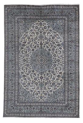 Lot 58 - A Persian Kashan carpet