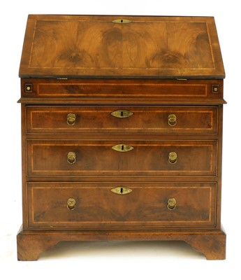 Lot 91 - A yew, crossbanded and feather-banded bureau
