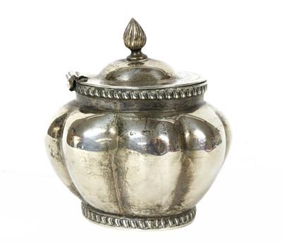 Lot 24 - An oval, lobed, silver tea caddy