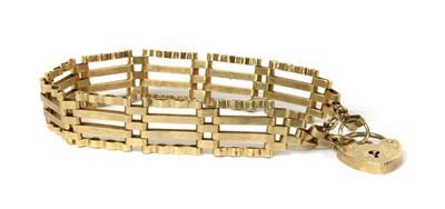 Lot 71 - A 9ct gold four row gate bracelet