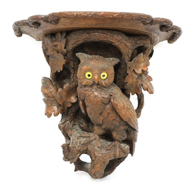 Lot 73 - A Black Forest carved softwood wall bracket