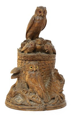 Lot 61 - A Black Forest carved softwood tobacco box and cover