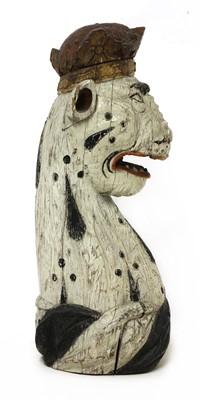 Lot A carved and painted oak armorial leopard head