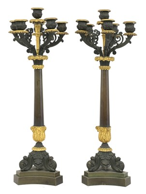 Lot 32 - A pair of French Empire bronze and parcel gilt candelabrum