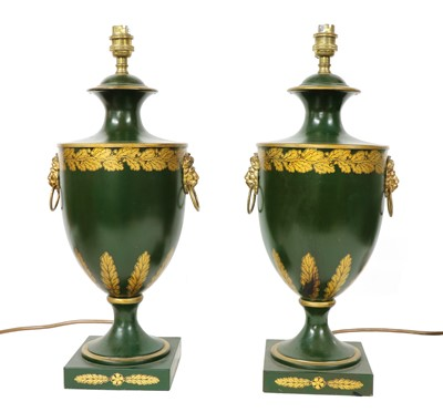 Lot 105 - A pair of Toleware table lamps