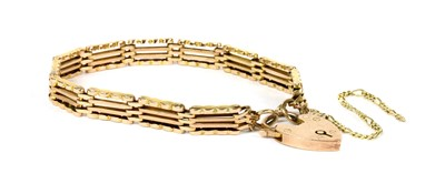 Lot 72 - A gold four row gate bracelet