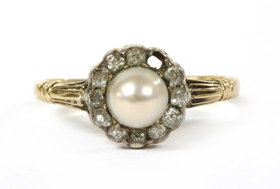 Lot 29 - A gold pearl and diamond cluster ring