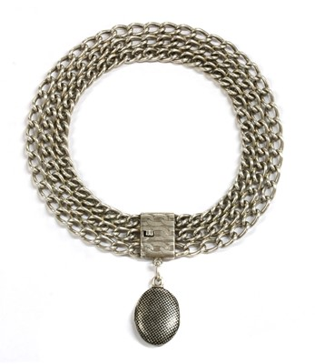 Lot 48 - A silver niello locket and choker