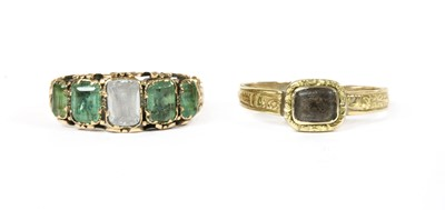 Lot 18 - A Victorian gold white gemstone and emerald ring