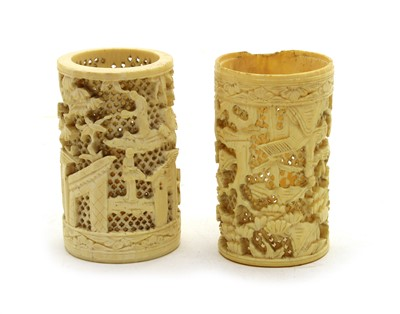 Lot 116 - A pair of early 20th century Japanese ivory cylindrical brush holders