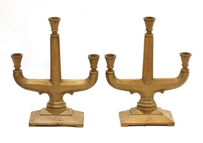 Lot 98 - A pair of fruitwood three-branch candelabra