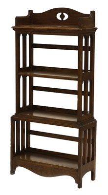 Lot 33 - An Arts and Crafts oak four-tier open bookcase