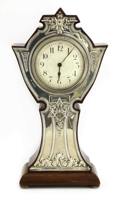 Lot 3 - An Art Nouveau silver-mounted mantel clock