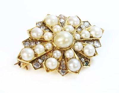 Lot 98 - A Victorian gold split pearl and diamond star brooch or motif