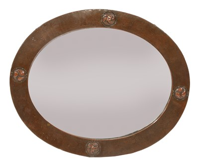 Lot 42 - A Liberty oval copper wall mirror