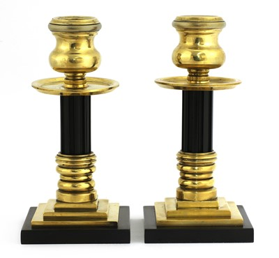 Lot 115 - A pair of bronze and Bakelite candlesticks
