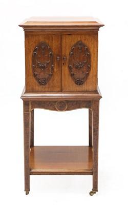 Lot 39 - A Scottish Arts and Crafts walnut, oak and burrwood cabinet