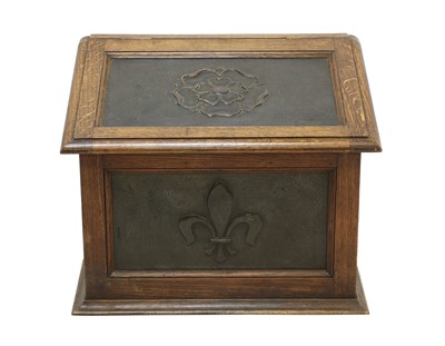 Lot 43 - An Arts and Crafts oak and copper-mounted log bin