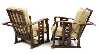 Lot 114 - A pair of Art Deco oak reclining armchairs