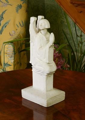 Lot 44 - A plaster figure of a kneeling angel