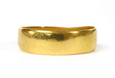 Lot 56 - A 22ct gold flat section wedding ring
