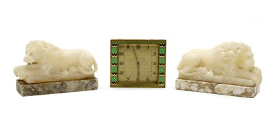 Lot 112 - A mirrored pair of carved alabaster Canova style lions