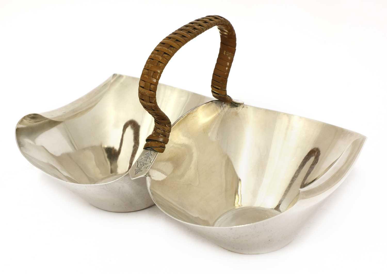 Lot 20 - A silver double basket or bonbon dish