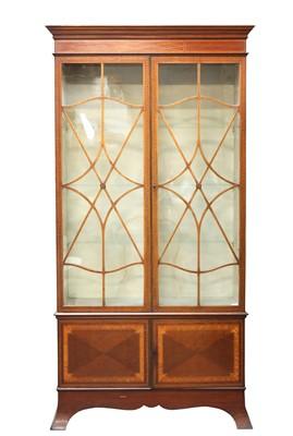 Lot 32 - A mahogany inlaid cabinet